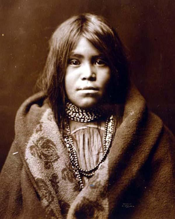 Young Apache Girl. Taken in 1903 by Edward S. Curtis.    The picture presents Indians of North America.
