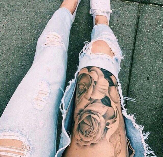black and white rose thigh tattoo
