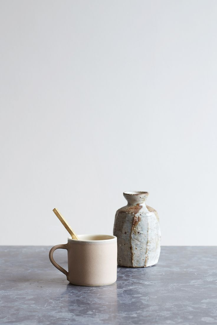 A smaller companion to the large hand thrown mug by ceramicist Sue Ure. Ideal as a smaller coffee or tea cup. Taupe glaze exclusive to Oggetto.