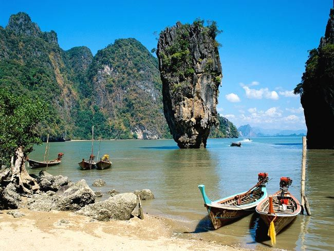 PHANG NGA BAY, THAILAND  One of the most popular day trips from Phuket, Phang Nga Bay is a stunning yet strange sight with towering limestone cliff in improbable shapes. One of the most popular of the bay's 42 island is James Bond Island, so named because it was prominently featured in two Bond films.  Picture: Flickr user Rajkumar