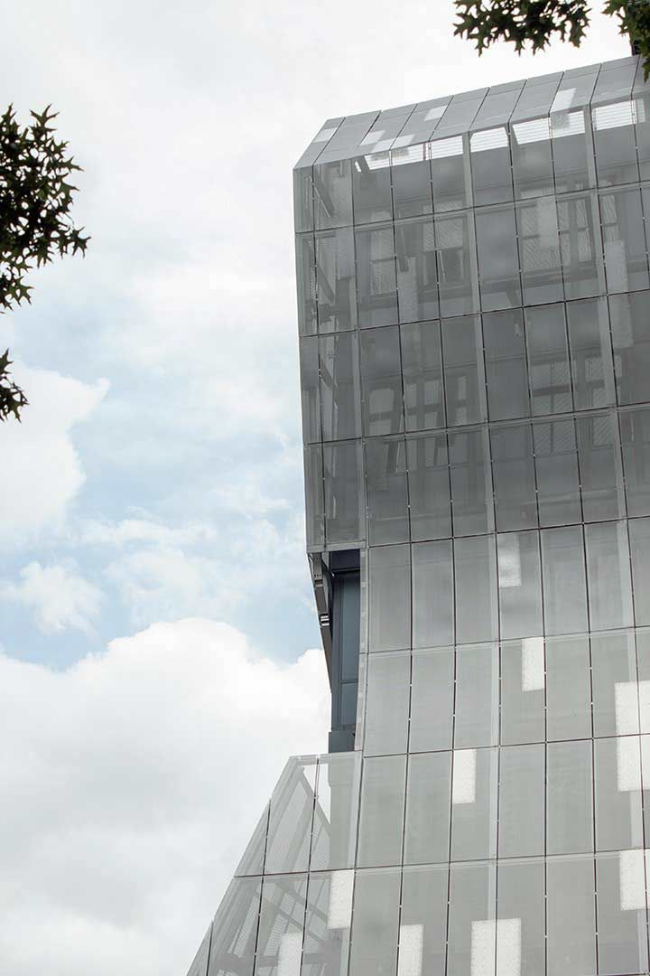 Detail Of The Curving Perforated Metal Facade