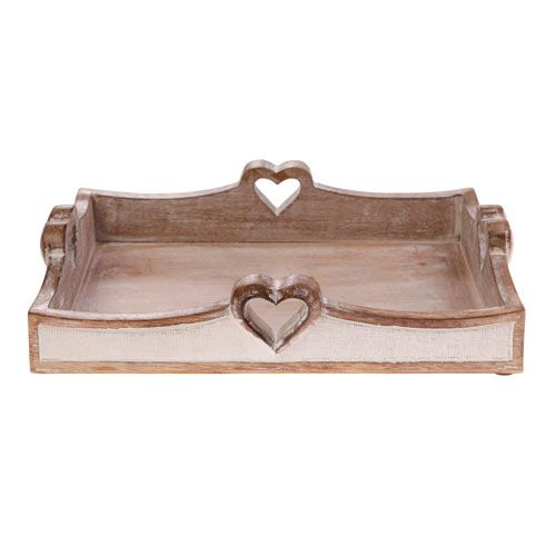 Serve up drinks, snacks and meals with a lot of love using this pretty wooden tray featuring four carved-out hearts.