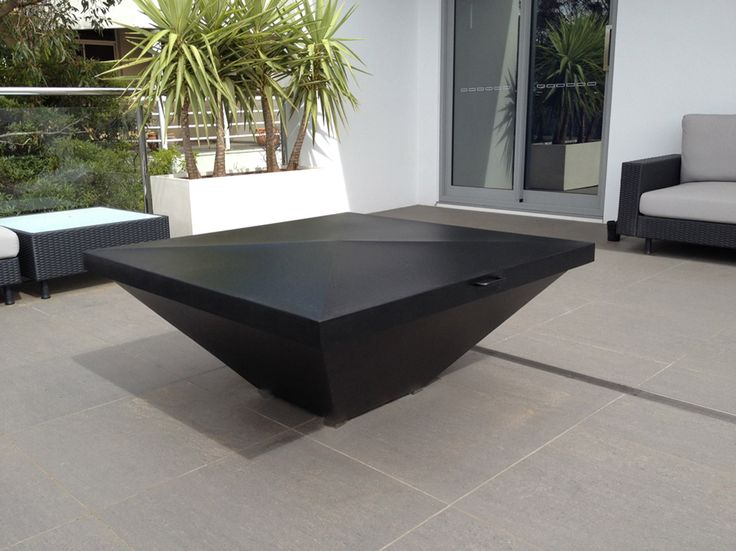 Caminus 1100 Fire Pit with custom-made cover is featured as the highlight of an outdoor terrace entertainment area. www.estiadesign.com.au