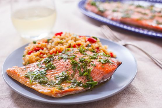 I am just starting to like fish... but this was simple and awesome. You will need 2 (15 x 6-inch) cedar grilling planks, and plan ahead the planks must be soaked in water for a minimum of 9 hours! This is a never fail recipe with complete instructions for the best tasting cedar-plank salmon you will ever have! Try to use seasoned salt for this, it really brings out tons of flavor! This salmon is even delicious without the lemon topping, adjust all ingredients to taste for the topping.