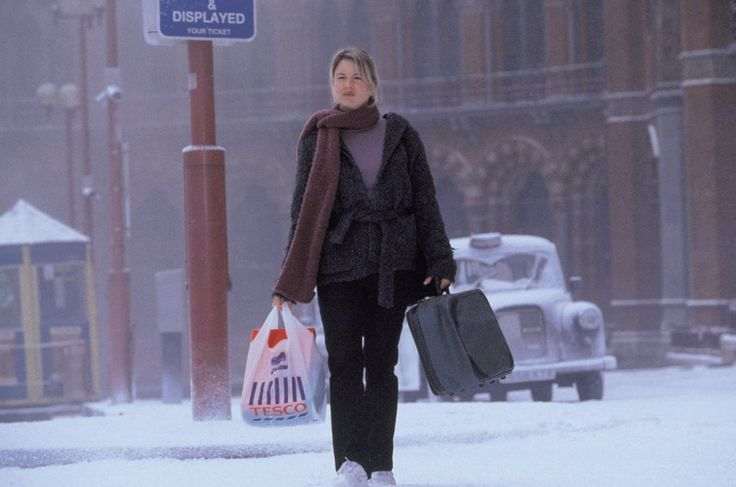 Bridget Jones's Diary (2001). With London in snow, Bridget Jones (Renée Zellweger) steps out in a long purple scarf, grey coat and a lilac jumper. But we're calling that plastic bag accessory a fashion no-no