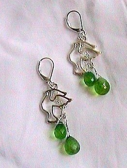 Dove- Green Quartz Sterling Silver Earrings  A sterling Silver dove nestled in front of two st. silver chains, each ending with a brilliant faceted crystal green quartz briolette gemstone. Sterling Silver leverback closures. www.SoulReflectionDesign.etsy.com