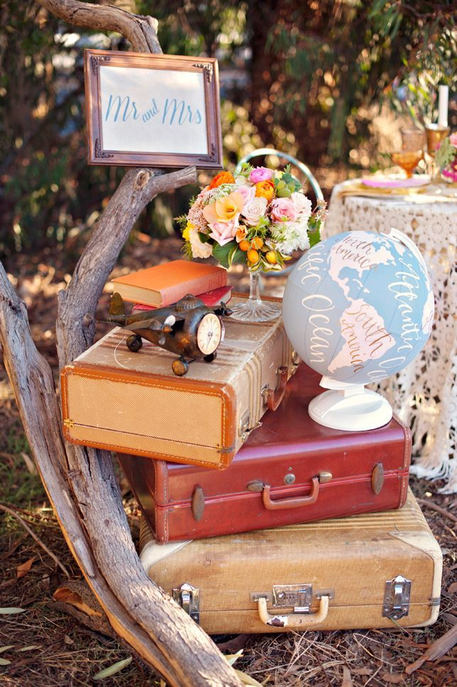 vintage suitcases, airplanes and globes for travel theme.  Love the globe.  Use seasonal flowery