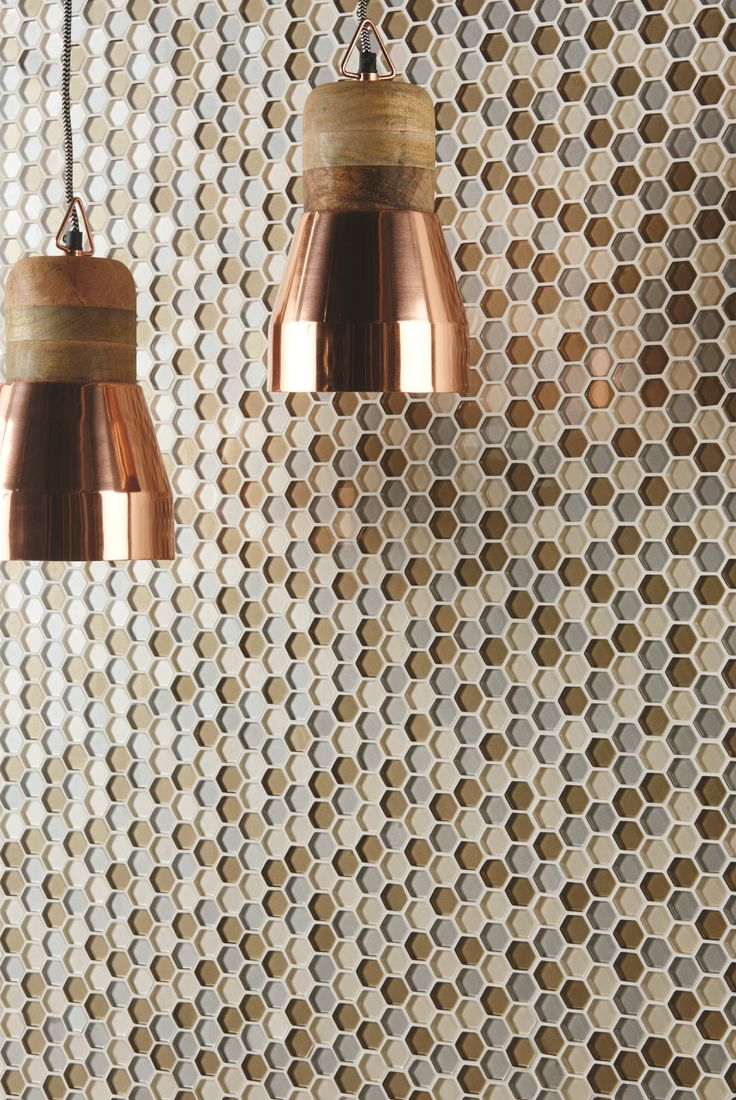 Selene glass mosaics show why hexagons are the shape of the moment. These tiles look great on walls to provide a subtle effect with depth, thanks to the metallic finish in each tile. originalstyle.com