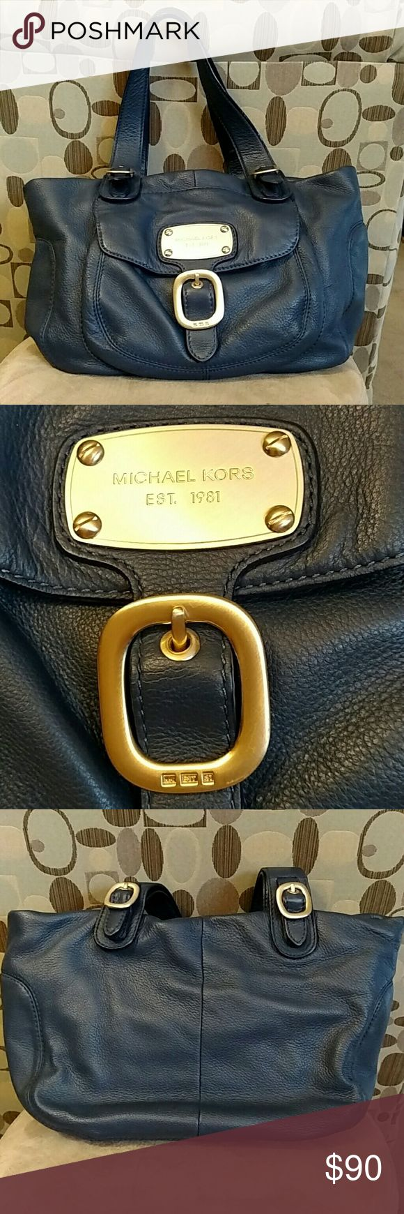 Michael Kors navy slouchy hobo handbag This is been my go-to bag so often, but it is still in great condition. The only real imperfections are on the straps?, shown the last picture. The gold hardware has almost no wear. This is a true navy color. Full of pockets (1 outside snap, 4 inside slip, 1 inside zip) and the top zips closed.  17x10x6 Michael Kors Bags Hobos