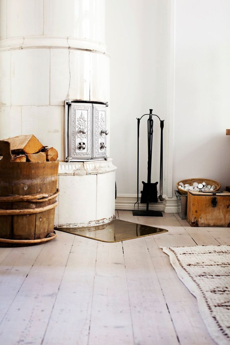 love this white fireplace with the stacks of wood beside x