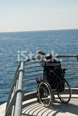 Man on Wheelchair Near the Seaside Royalty Free Stock Photo