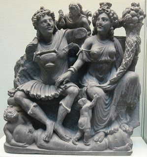 The Ancient Greek diaspora spread over half of Eurasia: Greek India in the time of Buddha and Jesus - Gandhara was a center of Greek influenced Buddhism until the end of the Roman Empire. This is a sculpture of Buddhist gods on the left wearing a greek fustanella from the 3rd century AD, which shows a clear influence from Greek art of the time. Therefore a vibrant Hellenic community lasted in India at least four centuries after Christ.