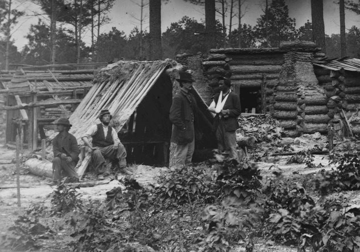 Union soldiers at captured Confederate encampment during the siege of Petersburg, June 1864. Timothy O'Sullivan