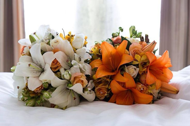 Lily, orchid, alstro and rose hand tied bouquets. Little flower lane.