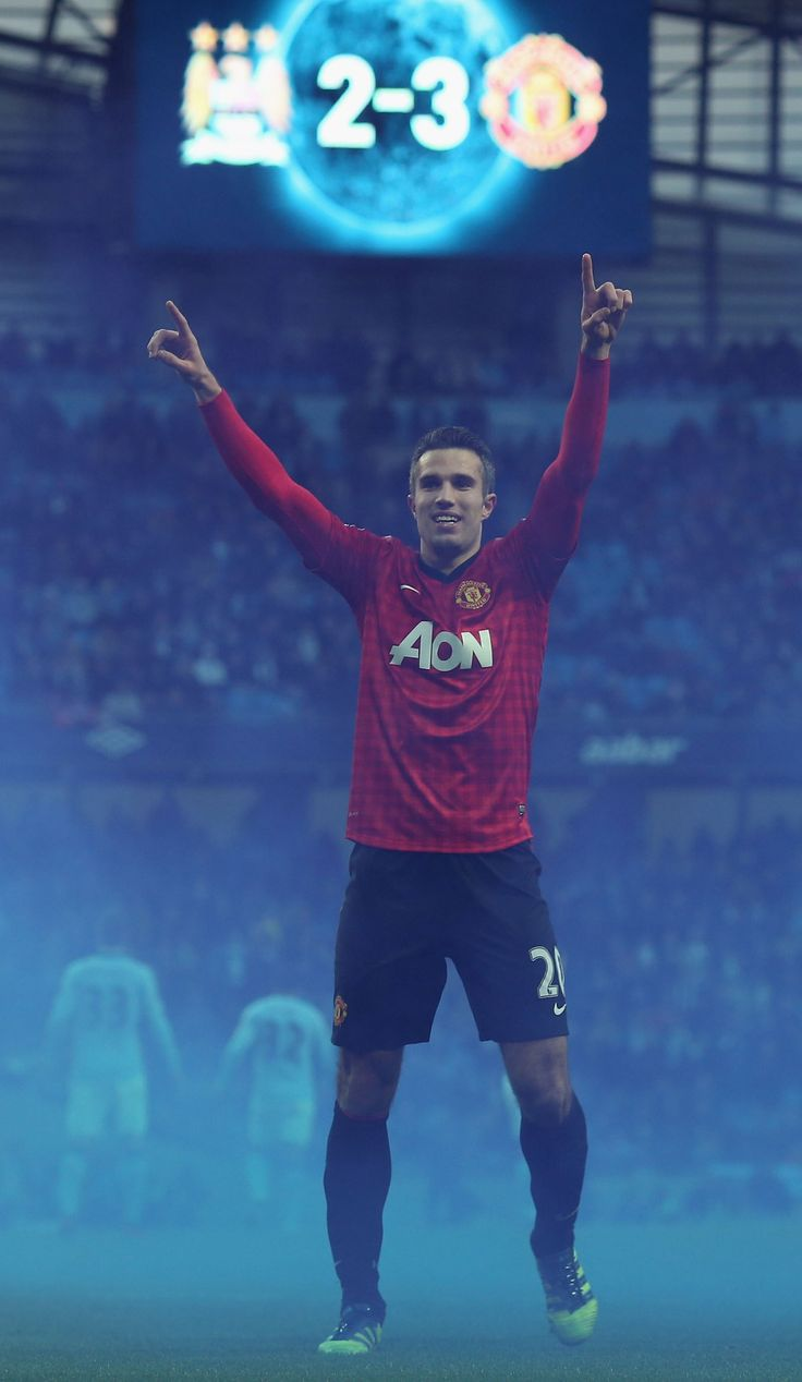 @manutd forward Robin van Persie salutes the jubilant away support after scoring the winner in the 2012 Manchester derby at the Etihad Stadium.