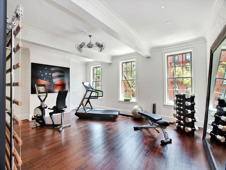 Home Gym Design Ideas large cardio and weight machine home gym with televisions on the wall 20 Of The Most Outrageous Home Gym Designs