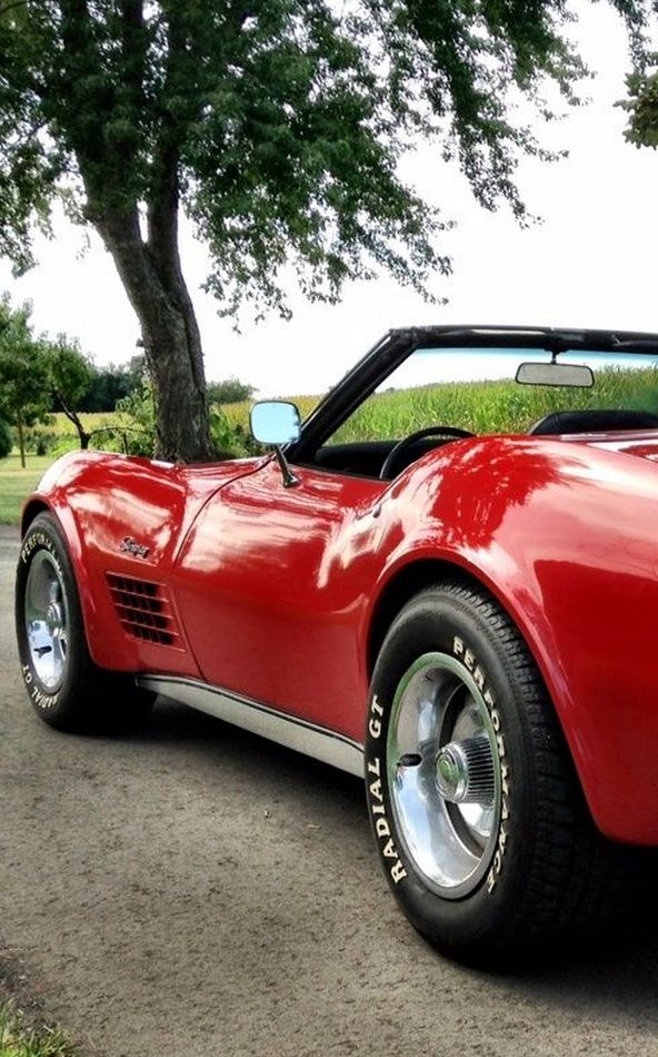 Cherry Red Corvette for sunset cruises and the top rolled down. Does life get any better?