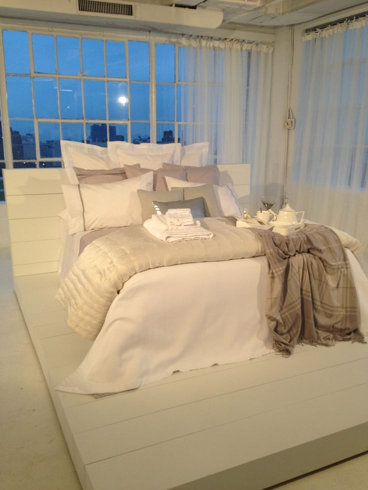 Zara Home Launch Party love the cozy look of this bed. and the thing its standing on!