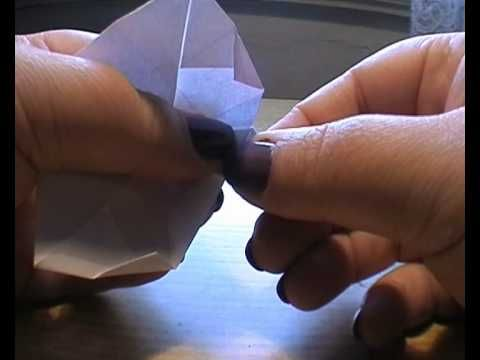 Tomiko Fuse's lamp shape box. Modular. The video_ demonstrator's nails are distracting. A nicer looking model is here: http://www.papercraftcentral.net/wp-content/uploads/2011/10/Origami-Box-Lamp-Shaped-Bowl-Lid-with-Knob.jpg
