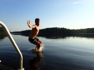 Swimming in a forest lake in Nuuksio National Park