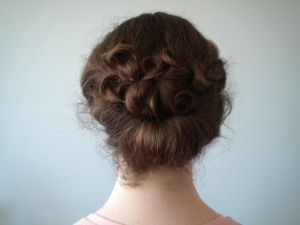 When you add the curly locks, this really looks like a Gibson Girl-- just lift it up higher for the real McCoy!!!