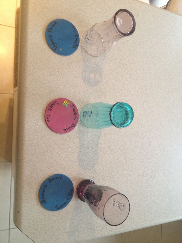 Sick of having so many dirty glasses/ cups around. Put a coaster with each child's name on it for one glass/ cup a day. Works a treat for us!! No more having 20 dirty glasses a day