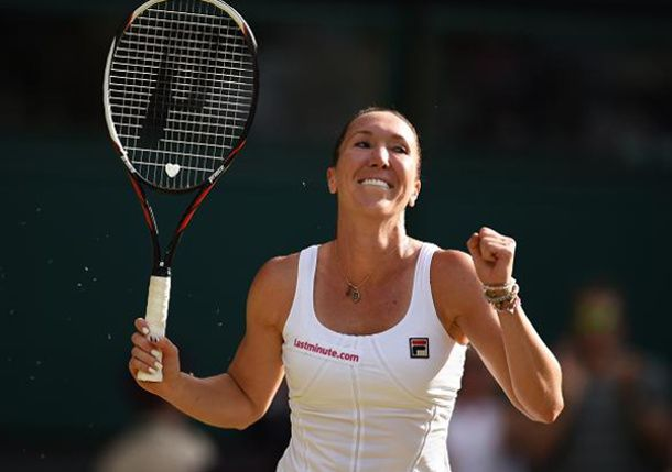 ^Jelena Jankovic shocks defending champ Petra Kvitova out of Wimbledon.