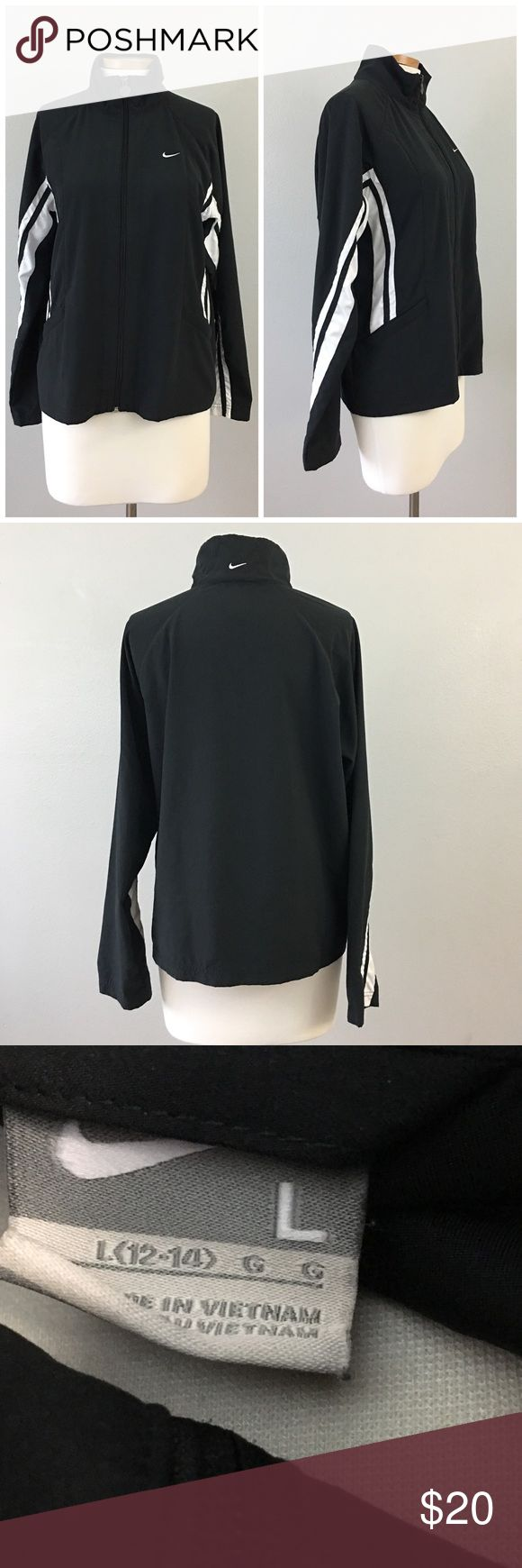 Nike Black & White Stripe Zip Up Track Jacket Nike Black & White Stripe Zip Up Track Jacket. Size large 12-14, runs slightly small. Would fit a 10-12 best! Thank you for looking at my listing. Please feel free to comment with any questions (no trades/modeling).  •Condition: very good! No visible holes or stains.   ✨Bundle and save!✨10% off 2 items, 20% off 3 items & 30% off 5+ items! KB Nike Jackets & Coats
