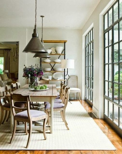 Design by Suzanne Kasler ... Hardwood floors, barn-style light fixtures, black window frames & muntins, farmhouse table