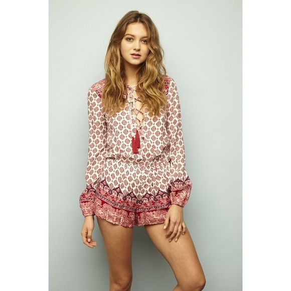Boho Printed Lace Up Long Sleeve Romper Printed tie up long sleeve romper. Unlined  Imported. Pants Jumpsuits & Rompers