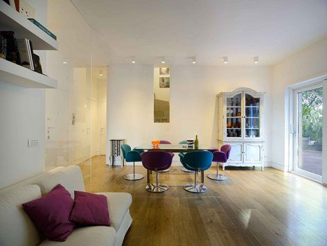 MIA house, Rome, 2015 - arabella rocca - Have a nice diner on these Little Tulip chairs designed by Pierre Paulin for Artifort.