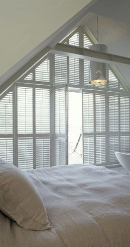 You can cover even the largest windows with shutters and control the light that comes in. These are the Woodlore Plantation Shutters.