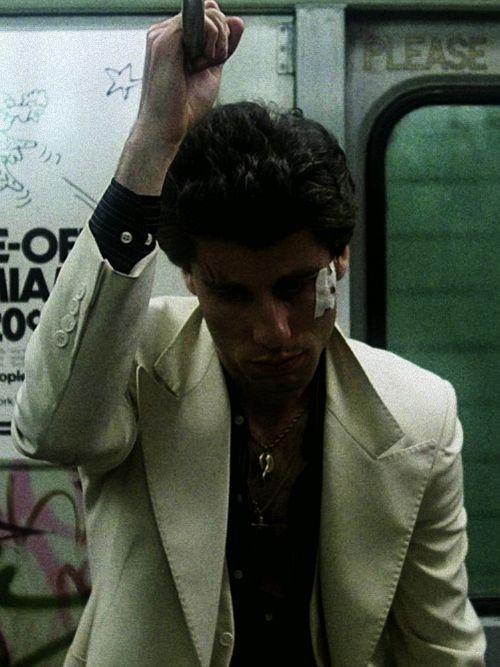 "John Travolta in character as ""Tony Manero"" in a screen still from ""Saturday Night Fever"", 1977"