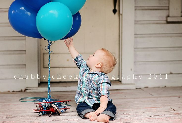 Balloons tied to an airplane. Or use truck, bike, car... Must do 1st birthday idea