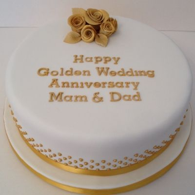 Golden Wedding Anniversary cake decorated with roses and gold sugar pearls