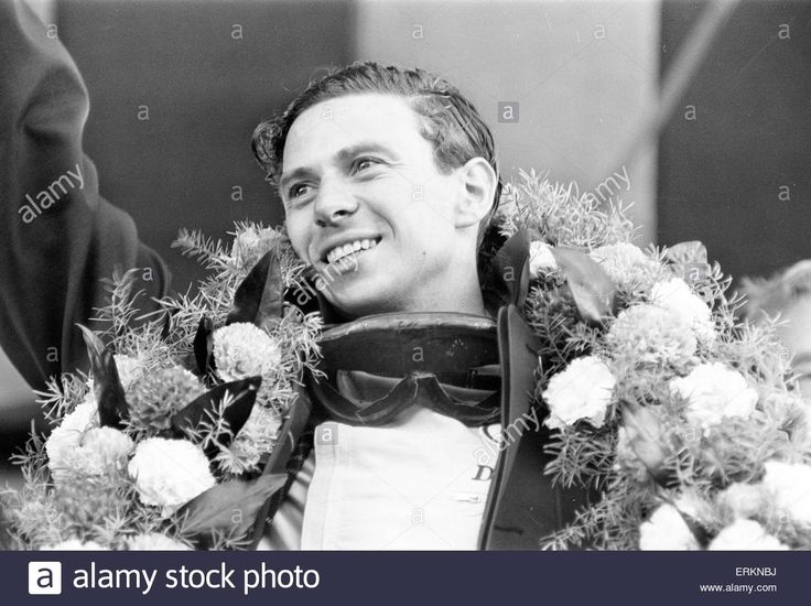 Download this stock image: Jim Clark, British Formula One racing driver for Lotus-Climax, pictured celebrating after winning British Grand Prix at Brands Hatch, 10th July 1964. - ERKNBJ from Alamy's library of millions of high resolution stock photos, illustrations and vectors.