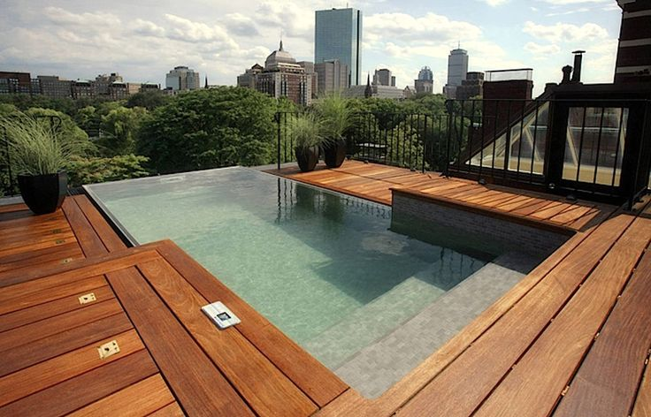 An urban dweller's paradise, this pool sits on the rooftop of a Boston Brownstone overlooking Boston Public Gardens.