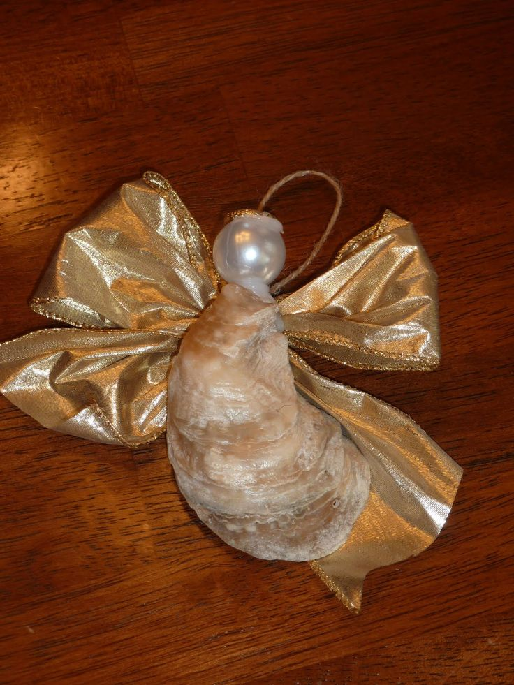 8 best sea shell creations images on pinterest shells for Big seashell crafts