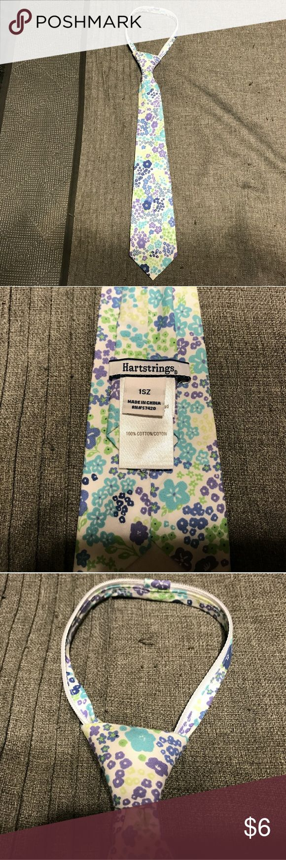 Kids Floral Zipper Tie This is a kids zipper tie by hartstrings that has a floral pattern with green, purple, and blue flowers and a white background.  The tie is one size and it's a zipper tie which makes it adjustable. This tie is in excellent condition. Hartstrings Accessories Ties