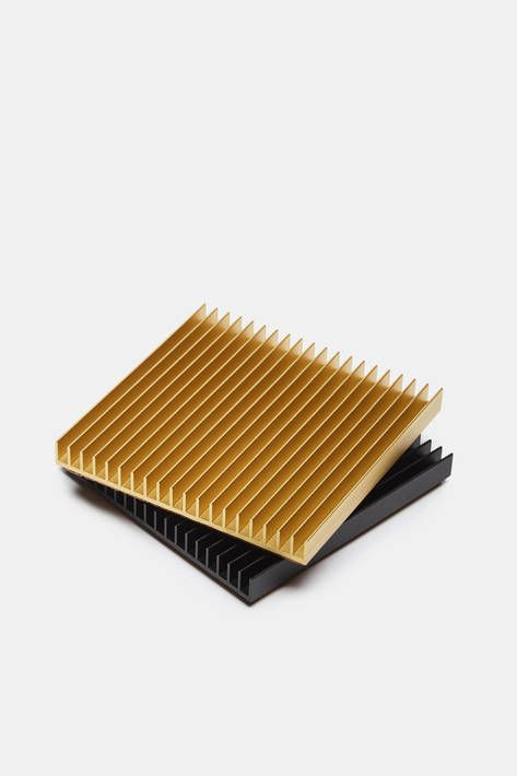 Designer Shaun Kasperbauer, co-founder of Brooklyn-based Souda, refines traditional tabletop accessories to their architectural essence. This ribbed square of anodized aluminum is produced through a unique partnership with a manufacturer of industrial heat sinks. Each cork-backed trivet is the result of a common yet complex manufacturing technique reimagined so as to combine the industrial and the domestic.
