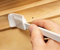 Filling nail holes, Putty application with spatula OMG this is a brilliant idea.. I ruined my fingers trying to fill trim nail holes in my last house.