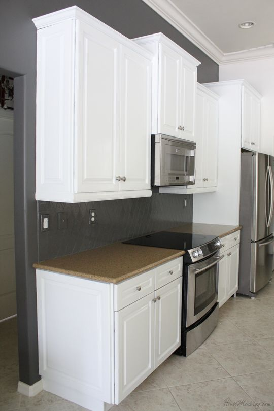 Charcoal paint & white cabinets. Our's are going to go to the ceiling, but we're going with the white for a more open, bright feel with gray as a contrast.