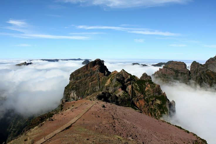 PICO DO AREEIRO at 1818 meters high (5965 feet), is Madeira Island's third highest peak. The views all around are stunning with clouds floating over the beautiful mountainous rock formations it's just impossible to describe. When weather permits the south coast, Curral das Freiras and even Porto Santo island can be seen from here.