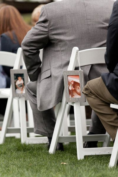 Lining the aisle with pics of the groom and bride! such a cute idea - this may also be easier and cheaper than other methods..hmmm :)