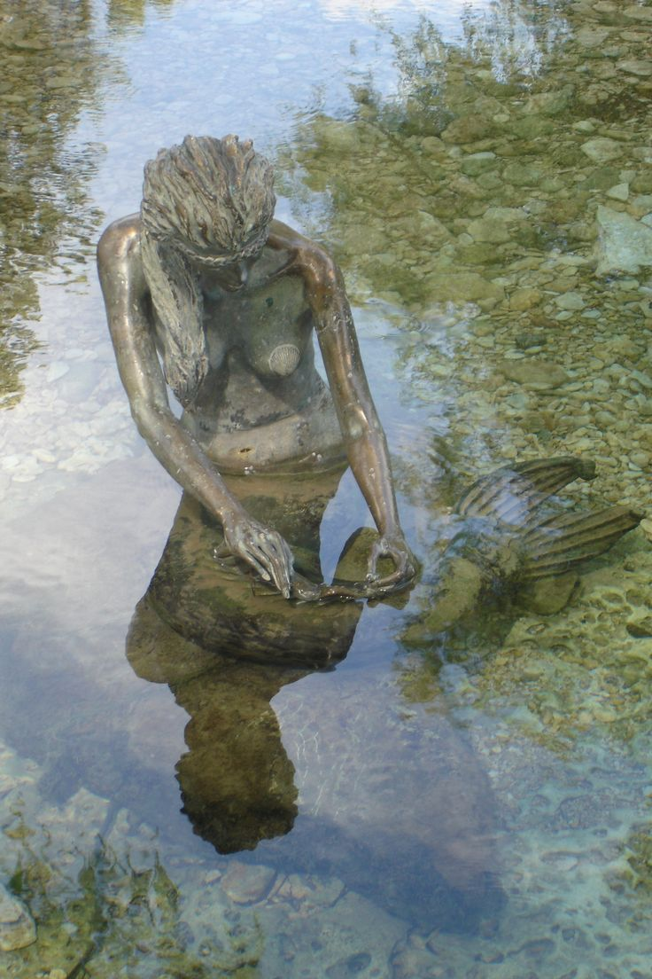 Mermaid sculpture in Salado Creek in central Texas - It blends into the natural rock so beautifully! <3