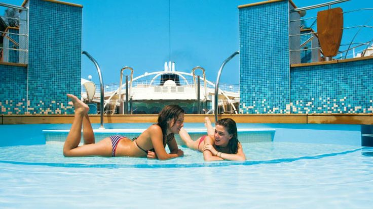 A drink on the sundeck, a dip in the warm #pool, a view of the #ocean… what a way to #cruise!