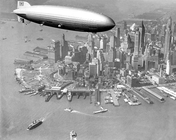 The zeppelin Hindenburg flies over Manhattan, April 1, 1936, a year before its fiery demise (May 6, 1937). The Hindenburg crossed the ocean in half the time of the fastest ocean liner.