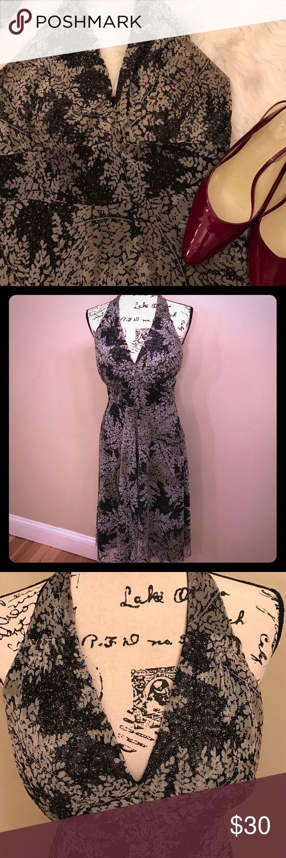 "Calvin Klein halter dress. Calvin Klein halter dress. Grey and black leaf pattern. Zipper up back. Shell 80% polyester 20% spandex. Lining 95% polyester 5% spandex. Hem is 30"" from lowest point of v neck Calvin Klein Dresses"