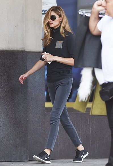 Olivia Palermo wearing black Nike trainers