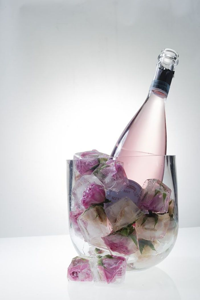 Pretty flowers in ice cubes for decoration.